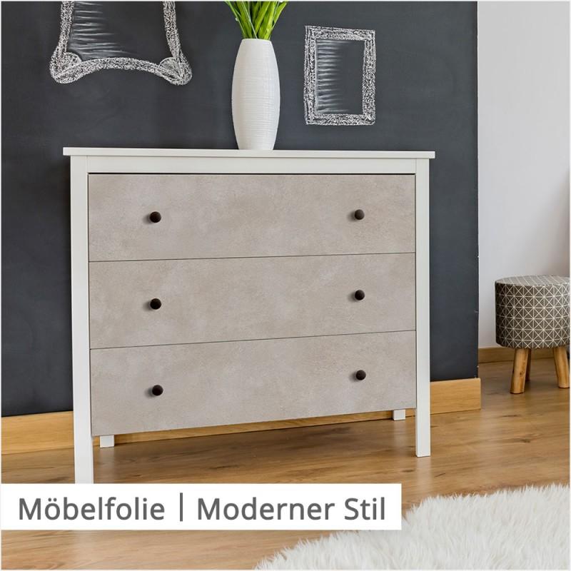 Für eine Einrichtung im modernen Stil verwendest du am besten helle Farben und geradlinige Konturen, wie diesen warm beigen Beton-Ton auf der Kommode.